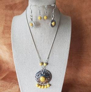 Unique silver and yellow necklace with earrings